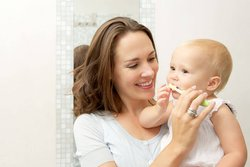 When should I start brushing baby teeth?