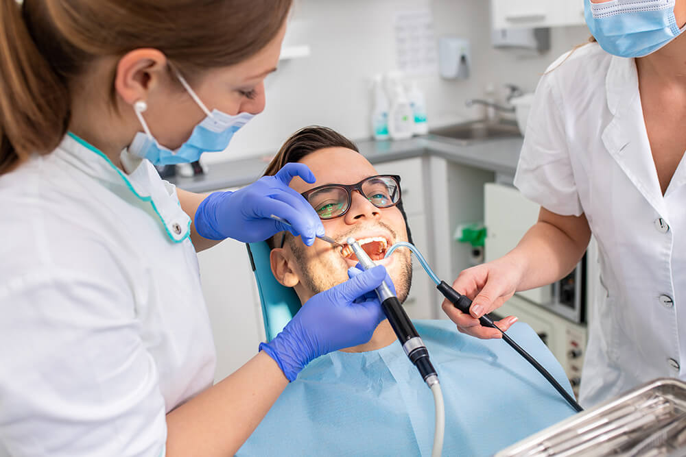 Professional teeth cleaning removes extrinsic tooth discolouration
